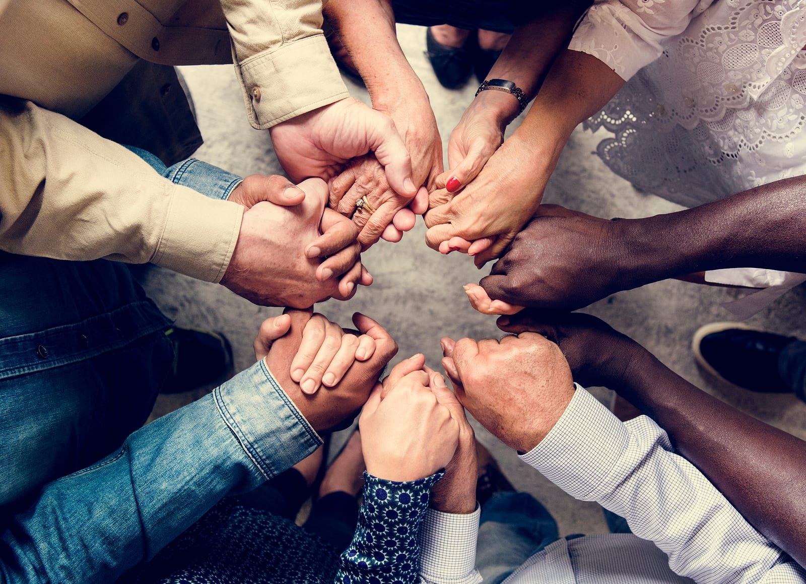 Group of diverse hands holding each other