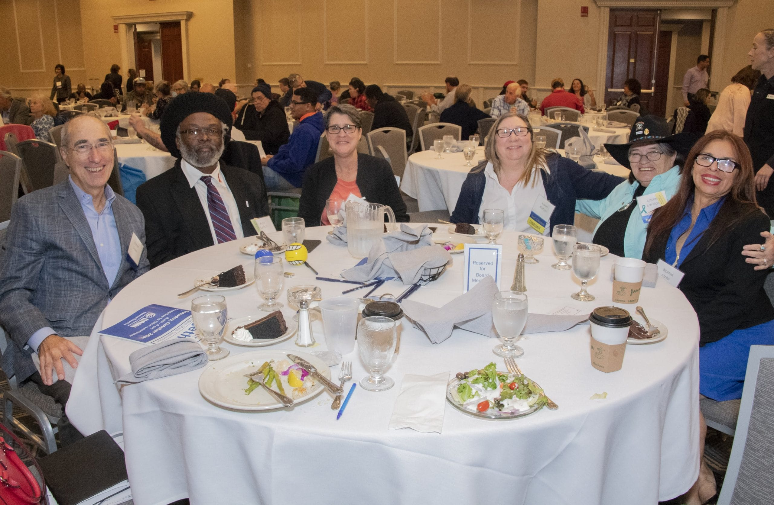 photo of NAMI Massachusetts Board of Directors members sitting around a table at the Convention