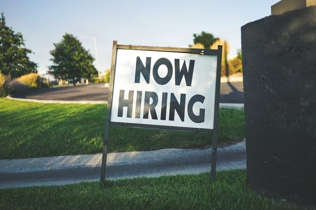 """lawn sign reading """"now hiring"""""""