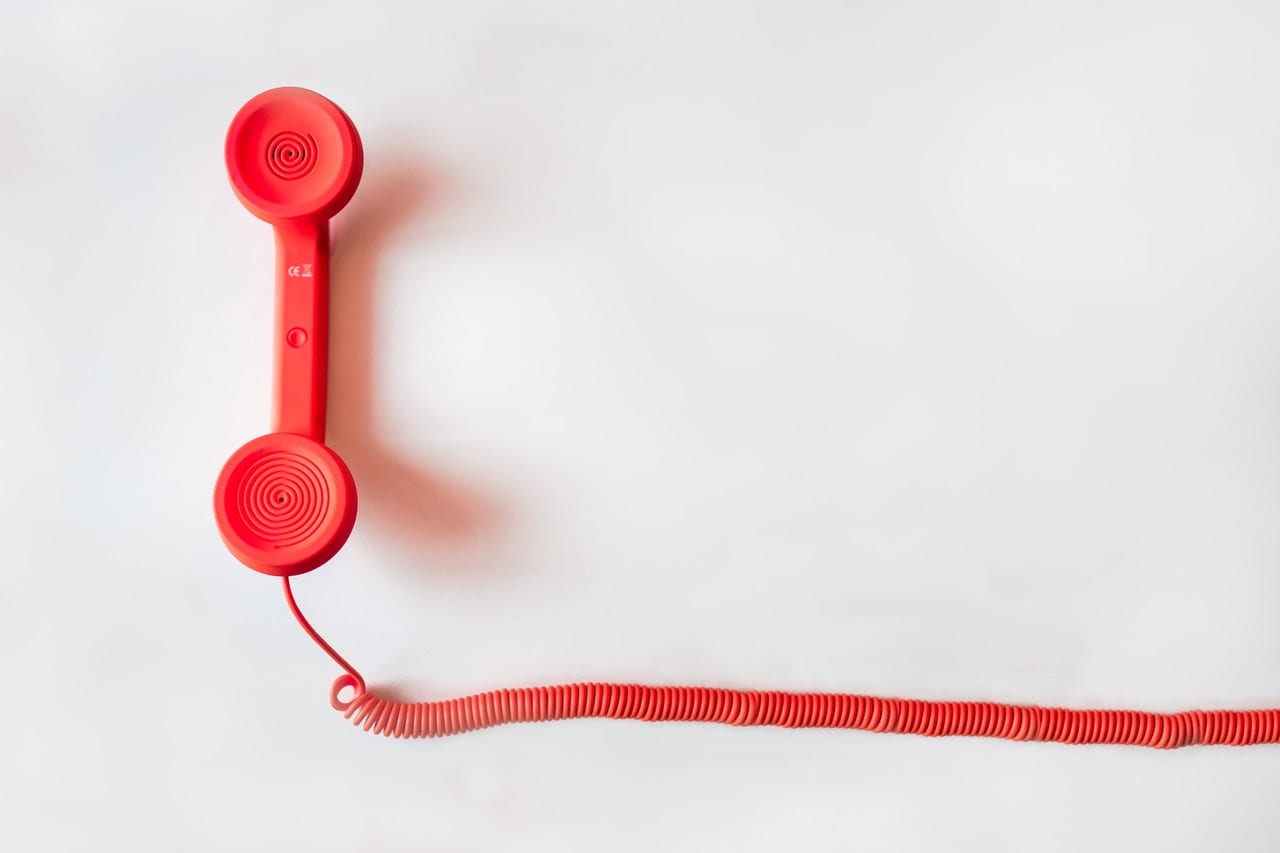 red telephone with cord